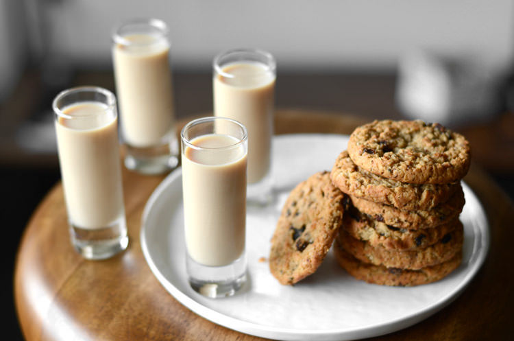 oatmeal cookie shots and cookies stacked on plate